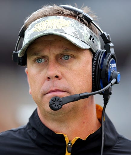 Nov 16, 2013; Hattiesburg, MS, USA; Southern Mississippi Golden Eagles head coach Todd Monken  watches from the sideline of their game against the Florida Atlantic Owls in the first half at M.M. Roberts Stadium. Mandatory Credit: Chuck Cook-USA TODAY Sports