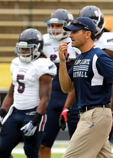 Nov 16, 2013; Hattiesburg, MS, USA; Florida Atlantic Owls head coach Brian Wright during pre-game warm ups before their game against the Southern Mississippi Golden Eagles at M.M. Roberts Stadium. Mandatory Credit: Chuck Cook-USA TODAY Sports