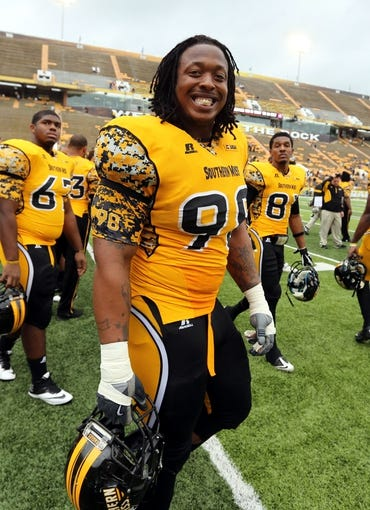 Nov 16, 2013; Hattiesburg, MS, USA; Southern Mississippi Golden Eagles defensive lineman Khyri Thornton (98) walks off the field after their game against the Florida Atlantic Owls at M.M. Roberts Stadium. Florida Atlantic won, 41-7. Mandatory Credit: Chuck Cook-USA TODAY Sports