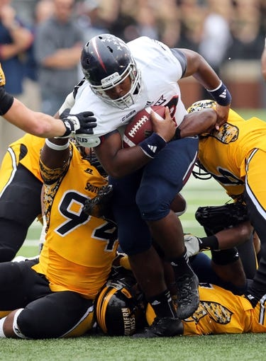 Nov 16, 2013; Hattiesburg, MS, USA; Florida Atlantic Owls quarterback Jaquez Johnson (12) runs against the Southern Mississippi Golden Eagles during the first half at M.M. Roberts Stadium. Mandatory Credit: Chuck Cook-USA TODAY Sports