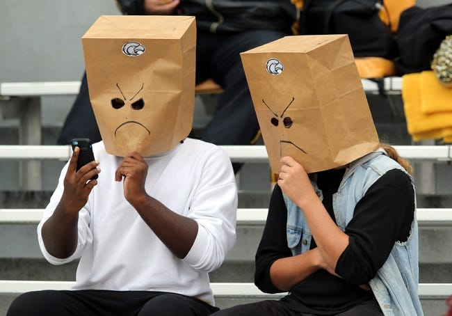 Nov 16, 2013; Hattiesburg, MS, USA; Southern Mississippi Golden Eagles fans wear bags during the first half of their game against the Florida Atlantic Owls at M.M. Roberts Stadium. Southern Miss extended their losing streak to 22 games with the loss to FAU. Mandatory Credit: Chuck Cook-USA TODAY Sports