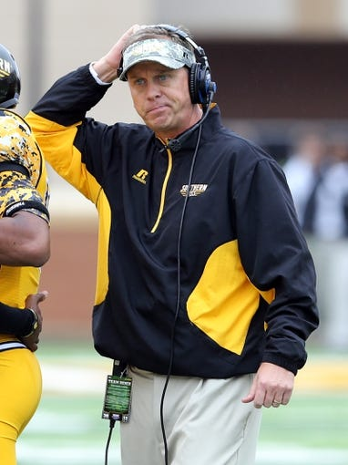 Nov 16, 2013; Hattiesburg, MS, USA; Southern Mississippi Golden Eagles head coach Todd Monken  watches from the sidelines of their game against the Florida Atlantic Owls in the first half at M.M. Roberts Stadium. Mandatory Credit: Chuck Cook-USA TODAY Sports