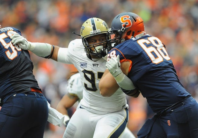 Nov 23, 2013; Syracuse, NY, USA; Pittsburgh Panthers defensive lineman Aaron Donald (97) is blocked by Syracuse Orange guard Nick Robinson (68) during the second quarter at the Carrier Dome.  Pittsburgh defeated Syracuse 17-16.  Mandatory Credit: Rich Barnes-USA TODAY Sports