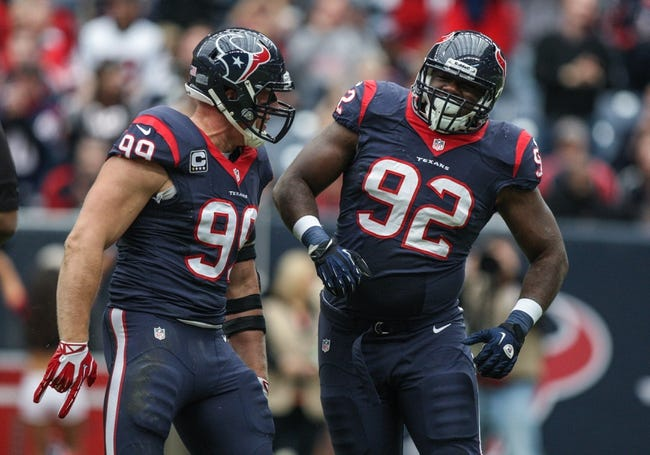 Nov 24, 2013; Houston, TX, USA; Houston Texans defensive end J.J. Watt (99) and nose tackle Earl Mitchell (92) celebrate after Mitchell makes a sack during the first quarter against the Jacksonville Jaguars at Reliant Stadium. Mandatory Credit: Troy Taormina-USA TODAY Sports