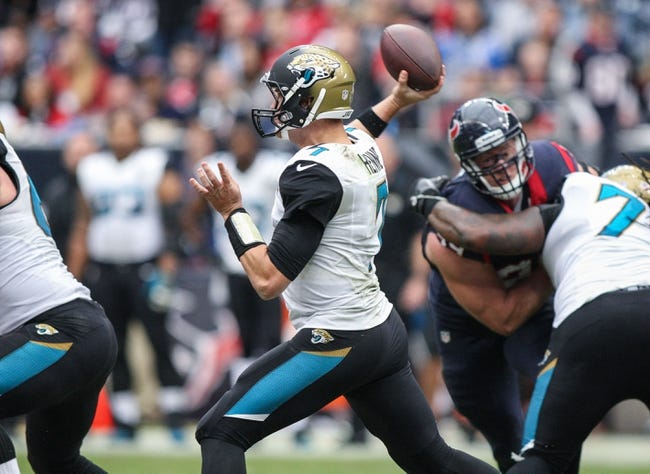 Nov 24, 2013; Houston, TX, USA; Jacksonville Jaguars quarterback Chad Henne (7) attempts a pass during the first quarter against the Houston Texans at Reliant Stadium. Mandatory Credit: Troy Taormina-USA TODAY Sports