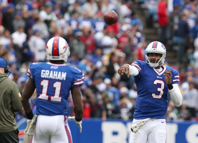 Nov 17, 2013; Orchard Park, NY, USA; Buffalo Bills quarterback EJ Manuel (3) throws the ball to wide receiver T.J. Graham (11) during a timeout against the New York Jets at Ralph Wilson Stadium. Mandatory Credit: Timothy T. Ludwig-USA TODAY Sports