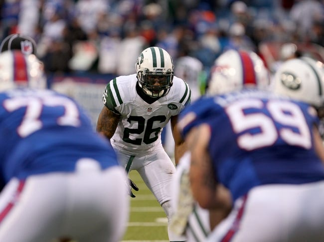 Nov 17, 2013; Orchard Park, NY, USA; New York Jets strong safety Dawan Landry (26) waits for the snap against the Buffalo Bills at Ralph Wilson Stadium. Bills beat the Jets 37 to 14.  Mandatory Credit: Timothy T. Ludwig-USA TODAY Sports