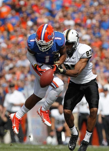 Nov 9, 2013; Gainesville, FL, USA; Florida Gators defensive back Vernon Hargreaves III (1) defends Vanderbilt Commodores wide receiver Jordan Matthews (87) pass during the second quarter at Ben Hill Griffin Stadium. Mandatory Credit: Kim Klement-USA TODAY Sports