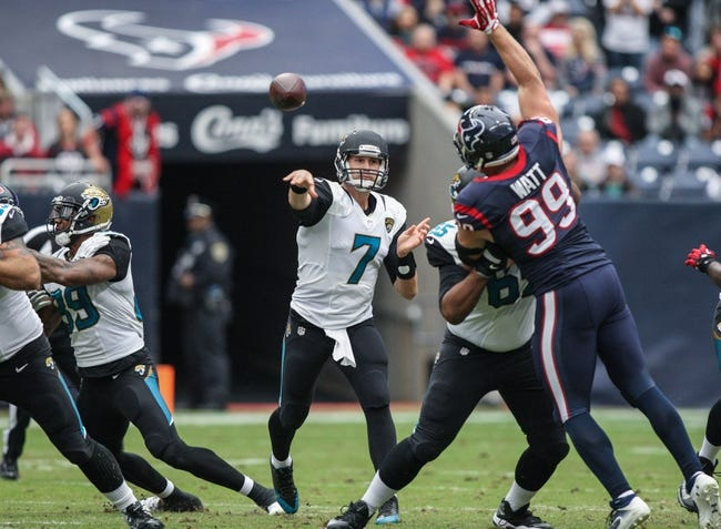 Nov 24, 2013; Houston, TX, USA; Jacksonville Jaguars quarterback Chad Henne (7) attempts a pass during the first quarter as Houston Texans defensive end J.J. Watt (99) defends at Reliant Stadium. Mandatory Credit: Troy Taormina-USA TODAY Sports