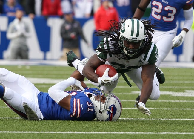 Nov 17, 2013; Orchard Park, NY, USA; Buffalo Bills free safety Jairus Byrd (31) tackles New York Jets running back Chris Ivory (33) during the first quarter at Ralph Wilson Stadium. Mandatory Credit: Timothy T. Ludwig-USA TODAY Sports