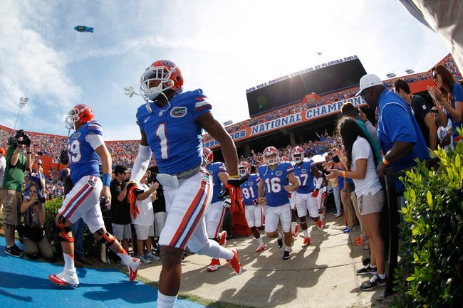 Nov 9, 2013; Gainesville, FL, USA; Florida Gators defensive back Vernon Hargreaves III (1) and teammates run out of the tunnel prior to the game against the Vanderbilt Commodores  during the first quarter at Ben Hill Griffin Stadium. Mandatory Credit: Kim Klement-USA TODAY Sports
