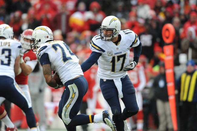 Nov 24, 2013; Kansas City, MO, USA; San Diego Chargers quarterback Philip Rivers (17) hands off to running back Ryan Mathews (24) during the second half of the game against the Kansas City Chiefs at Arrowhead Stadium. The Chargers won 41-38. Mandatory Credit: Denny Medley-USA TODAY Sports