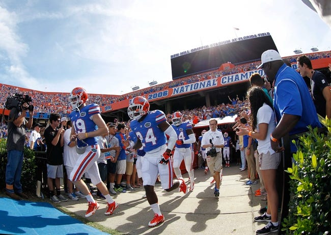 Nov 9, 2013; Gainesville, FL, USA; Florida Gators defensive back Brian Poole (24) and teammates run out of the tunnel prior to the game against the Vanderbilt Commodores  during the first quarter at Ben Hill Griffin Stadium. Mandatory Credit: Kim Klement-USA TODAY Sports