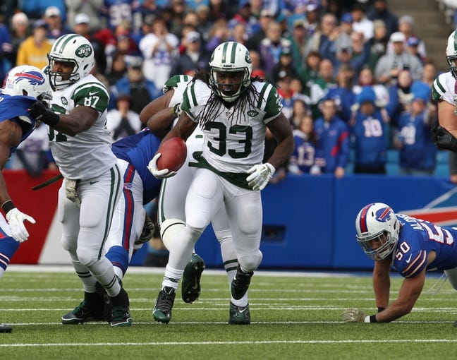 Nov 17, 2013; Orchard Park, NY, USA; New York Jets running back Chris Ivory (33) runs the ball against the Buffalo Bills at Ralph Wilson Stadium. Mandatory Credit: Timothy T. Ludwig-USA TODAY Sports
