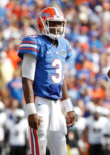 Nov 9, 2013; Gainesville, FL, USA; Florida Gators quarterback Tyler Murphy (3) against the Vanderbilt Commodores during the second quarter at Ben Hill Griffin Stadium. Mandatory Credit: Kim Klement-USA TODAY Sports