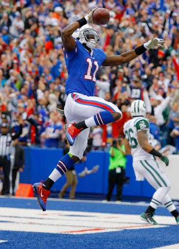 Nov 17, 2013; Orchard Park, NY, USA; Buffalo Bills wide receiver T.J. Graham (11) celebrates a touchdown against the New York Jets at Ralph Wilson Stadium. Mandatory Credit: Timothy T. Ludwig-USA TODAY Sports