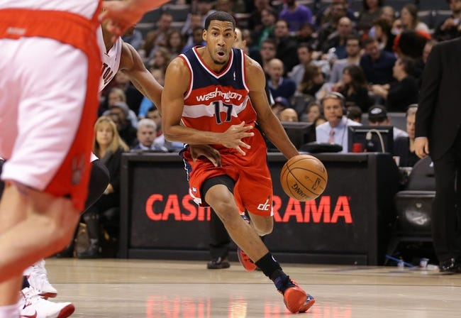Nov 22, 2013; Toronto, Ontario, CAN; Washington Wizards guard Garrett Temple (17) goes to the basket against the Toronto Raptors at Air Canada Centre. The Raptors beat the Wizards 96-88. Mandatory Credit: Tom Szczerbowski-USA TODAY Sports