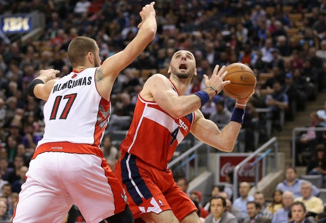 Nov 22, 2013; Toronto, Ontario, CAN; Washington Wizards center Marcin Gortat (4) looks to go up with the ball as he is guarded by Toronto Raptors center Jonas Valanciunas (17) at Air Canada Centre. The Raptors beat the Wizards 96-88. Mandatory Credit: Tom Szczerbowski-USA TODAY Sports
