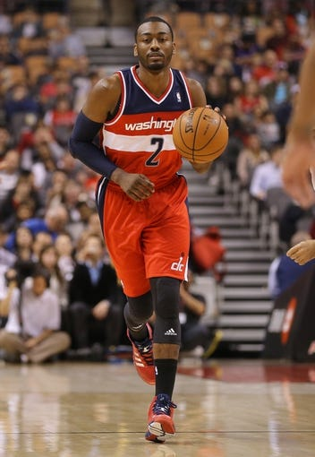 Nov 22, 2013; Toronto, Ontario, CAN; Washington Wizards point guard John Wall (2) advances the ball up the court against the Toronto Raptors at Air Canada Centre. The Raptors beat the Wizards 96-88. Mandatory Credit: Tom Szczerbowski-USA TODAY Sports