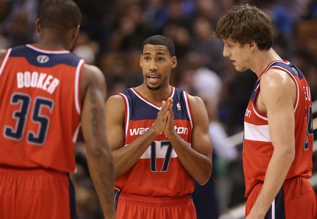 Nov 22, 2013; Toronto, Ontario, CAN; Washington Wizards guard Garrett Temple (17) talks to forward Trevor Booker (35) as forward Jan Vesely (24) against the Toronto Raptors at Air Canada Centre. The Raptors beat the Wizards 96-88. Mandatory Credit: Tom Szczerbowski-USA TODAY Sports