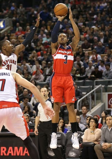 Nov 22, 2013; Toronto, Ontario, CAN; Washington Wizards shooting guard Bradley Beal (3) shoots as Toronto Raptors guard Terrence Ross (31) defends at Air Canada Centre. The Raptors beat the Wizards 96-88. Mandatory Credit: Tom Szczerbowski-USA TODAY Sports