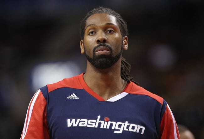 Nov 22, 2013; Toronto, Ontario, CAN; Washington Wizards forward Nene (42) warms up before playing against the Toronto Raptors at Air Canada Centre. The Raptors beat the Wizards 96-88. Mandatory Credit: Tom Szczerbowski-USA TODAY Sports