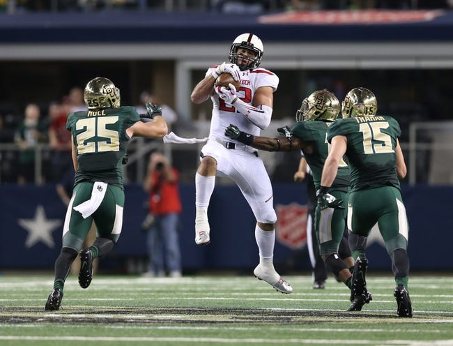 Nov 16, 2013; Arlington, TX, USA; Texas Tech Red Raiders tight end Jace Amaro (22) fights to catch a pass against the Baylor Bears at AT&T Stadium. The pass was broken up. Mandatory Credit: Matthew Emmons-USA TODAY Sports