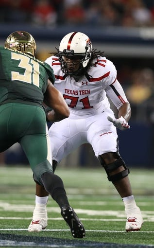 Nov 16, 2013; Arlington, TX, USA; Texas Tech Red Raiders tackle Rashad Fortenberry (71) in action against the Baylor Bears at AT&T Stadium. Mandatory Credit: Matthew Emmons-USA TODAY Sports