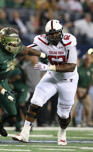 Nov 16, 2013; Arlington, TX, USA; Texas Tech Red Raiders tackle Le'Raven Clark (62) in action against the Baylor Bears at AT&T Stadium. Mandatory Credit: Matthew Emmons-USA TODAY Sports