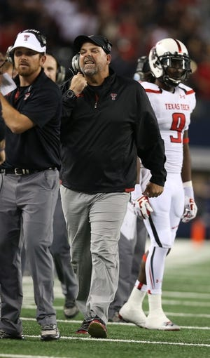 Nov 16, 2013; Arlington, TX, USA; Texas Tech Red Raiders offensive line coach Lee Hays yells on the sidelines during the game against the Baylor Bears at AT&T Stadium. Mandatory Credit: Matthew Emmons-USA TODAY Sports