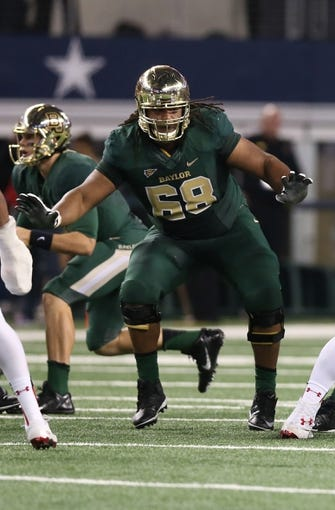 Nov 16, 2013; Arlington, TX, USA; Baylor Bears guard Cyril Richardson (68) in action against the Texas Tech Red Raiders at AT&T Stadium. Mandatory Credit: Matthew Emmons-USA TODAY Sports