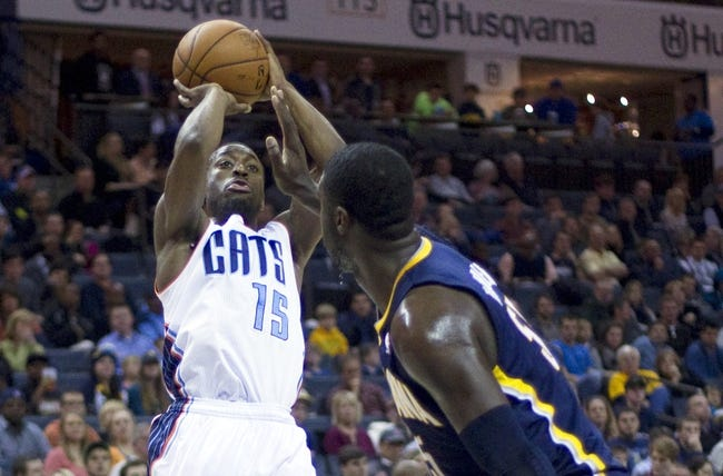 Nov 27, 2013; Charlotte, NC, USA; Charlotte Bobcats point guard Kemba Walker (15) shoots the ball during the first quarter against the Indiana Pacers at Time Warner Cable Arena. Mandatory Credit: Joshua S. Kelly-USA TODAY Sports