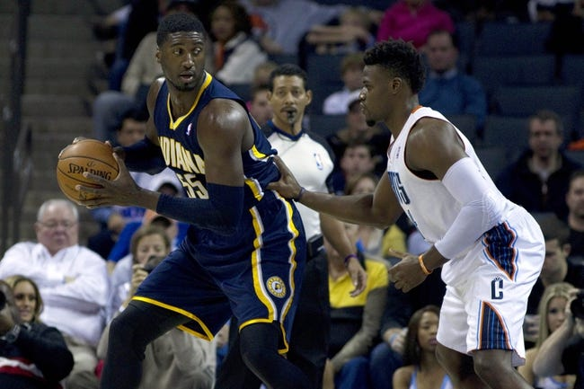 Nov 27, 2013; Charlotte, NC, USA; Indiana Pacers center Roy Hibbert (55) drives to the basket while being defended by Charlotte Bobcats power forward Jeff Adrien (right) during the first quarter at Time Warner Cable Arena. Mandatory Credit: Joshua S. Kelly-USA TODAY Sports