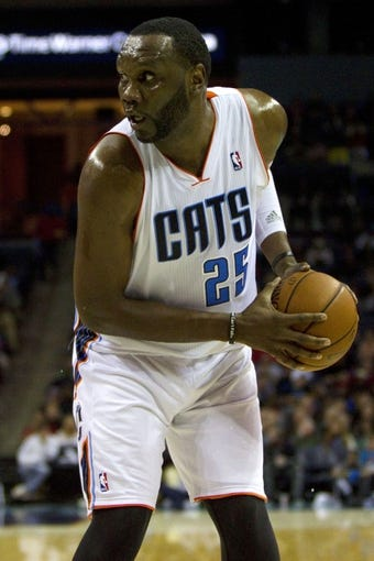 Nov 27, 2013; Charlotte, NC, USA; Charlotte Bobcats center Al Jefferson (25) looks to pass the ball during the second quarter against the Indiana Pacers at Time Warner Cable Arena. Mandatory Credit: Joshua S. Kelly-USA TODAY Sports