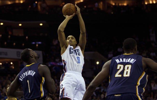 Nov 27, 2013; Charlotte, NC, USA; Charlotte Bobcats shooting guard Gerald Henderson (9) shoots the ball while being defended by Indiana Pacers shooting guard Lance Stephenson (1) during the second quarter at Time Warner Cable Arena. Mandatory Credit: Joshua S. Kelly-USA TODAY Sports