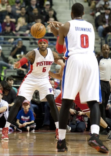 Nov 27, 2013; Auburn Hills, MI, USA; Detroit Pistons center Andre Drummond (0) passes the ball to small forward Josh Smith (6) during the second quarter against the Chicago Bulls at The Palace of Auburn Hills. Mandatory Credit: Raj Mehta-USA TODAY Sports