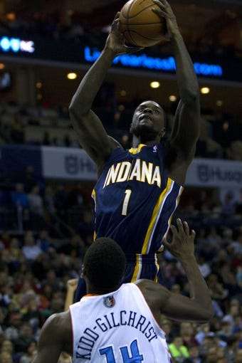 Nov 27, 2013; Charlotte, NC, USA; Indiana Pacers shooting guard Lance Stephenson (1) goes in for the layup while being defended by Charlotte Bobcats small forward Michael Kidd-Gilchrist (14) during the third quarter at Time Warner Cable Arena. Pacers won 99-74. Mandatory Credit: Joshua S. Kelly-USA TODAY Sports