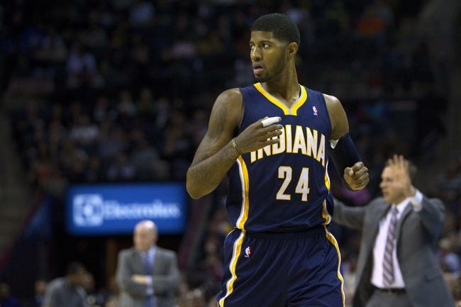 Nov 27, 2013; Charlotte, NC, USA; Indiana Pacers small forward Paul George (24) reacts during the fourth quarter against the Charlotte Bobcats at Time Warner Cable Arena. Pacers won 99-74. Mandatory Credit: Joshua S. Kelly-USA TODAY Sports
