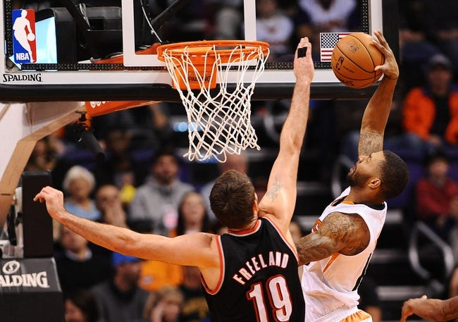 Nov 27, 2013; Phoenix, AZ, USA; Phoenix Suns forward Marcus Morris (15) is blocks by Portland Trail Blazers center Joel Freeland (19) in the first half at US Airways Center. Mandatory Credit: Jennifer Stewart-USA TODAY Sports