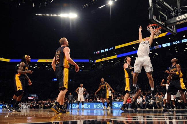 Nov 27, 2013; Brooklyn, NY, USA; Brooklyn Nets power forward Mason Plumlee (1) reverse dunks against the against the Los Angeles Lakers during the second half at Barclays Center. The Lakers won 99-94. Mandatory Credit: Joe Camporeale-USA TODAY Sports