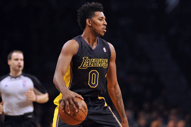 Nov 27, 2013; Brooklyn, NY, USA; Los Angeles Lakers small forward Nick Young (0) dribbles against the Brooklyn Nets during the first half at Barclays Center. The Lakers won 99-94. Mandatory Credit: Joe Camporeale-USA TODAY Sports