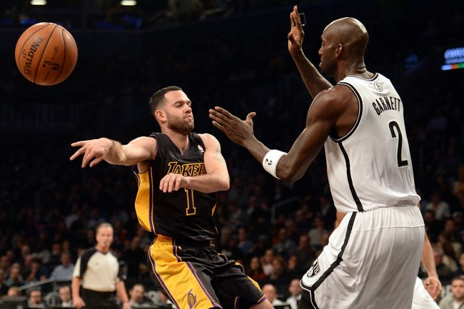 Nov 27, 2013; Brooklyn, NY, USA; Los Angeles Lakers point guard Jordan Farmar (1) makes a no look pass against the Brooklyn Nets during the first half at Barclays Center. The Lakers won 99-94. Mandatory Credit: Joe Camporeale-USA TODAY Sports