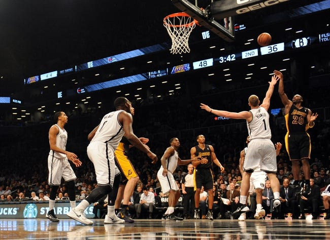 Nov 27, 2013; Brooklyn, NY, USA; Los Angeles Lakers shooting guard Jodie Meeks (20) puts up a shot over Brooklyn Nets power forward Mason Plumlee (1) during the first half at Barclays Center. The Lakers won 99-94. Mandatory Credit: Joe Camporeale-USA TODAY Sports