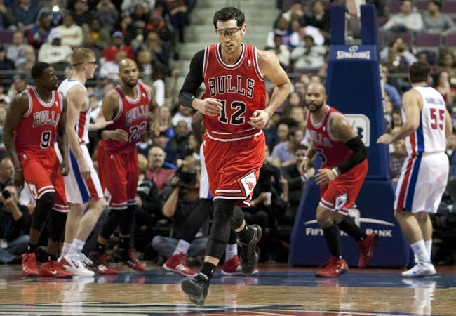 Nov 27, 2013; Auburn Hills, MI, USA; Chicago Bulls shooting guard Kirk Hinrich (12) jogs back up the court after making a shot during the third quarter against the Detroit Pistons at The Palace of Auburn Hills. Bulls beat the Pistons 99-79. Mandatory Credit: Raj Mehta-USA TODAY Sports