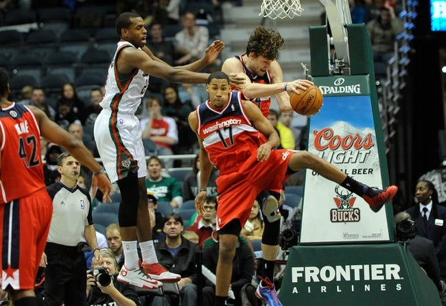 Nov 27, 2013; Milwaukee, WI, USA;   Milwaukee Bucks forward Khris Middleton (22) battles for a rebound against Washington Wizards forward Jan Vesely (24) and guard Garrett Temple (17) in the forth quarter at BMO Harris Bradley Center. Mandatory Credit: Benny Sieu-USA TODAY Sports