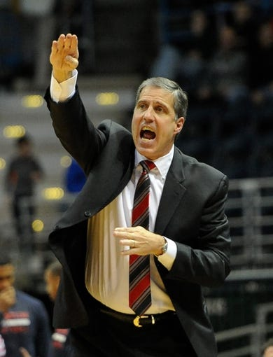 Nov 27, 2013; Milwaukee, WI, USA;   Washington Wizards head coach Randy Wittman calls a play in overtime during the game against the Milwaukee Bucks at BMO Harris Bradley Center. Mandatory Credit: Benny Sieu-USA TODAY Sports