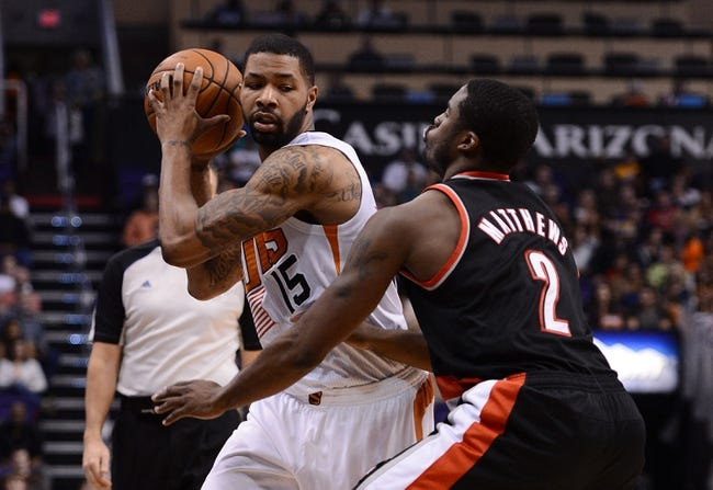 Nov 27, 2013; Phoenix, AZ, USA; Phoenix Suns forward Marcus Morris (15) holds the ball in front of Portland Trail Blazers guard Wesley Matthews (2) in the second half at US Airways Center. The Suns won 120-106. Mandatory Credit: Jennifer Stewart-USA TODAY Sports