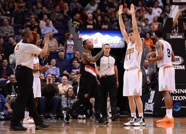 Nov 27, 2013; Phoenix, AZ, USA; Phoenix Suns guard Goran Dragic (1) reacts to a foul called by NBA official Tony Brothers (25) in the second half against the Portland Trail Blazers at US Airways Center. The Suns won 120-106. Mandatory Credit: Jennifer Stewart-USA TODAY Sports