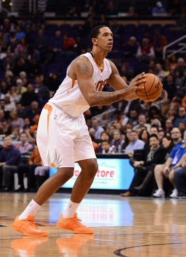Nov 27, 2013; Phoenix, AZ, USA; Phoenix Suns forward Channing Frye (8) shoots a basket against the Portland Trail Blazers in the second half at US Airways Center. The Suns defeated the Trail Blazers 120-106. Mandatory Credit: Jennifer Stewart-USA TODAY Sports