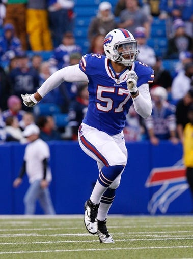 Nov 17, 2013; Orchard Park, NY, USA; Buffalo Bills linebacker Ty Powell (57) during the second half against the New York Jets at Ralph Wilson Stadium. Bills beat the Jets 37-14. Mandatory Credit: Kevin Hoffman-USA TODAY Sports